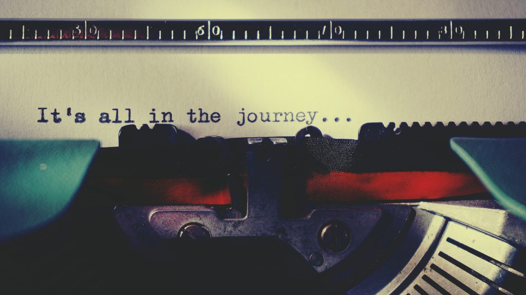 """typewriter paper with words """"It's all in the journey..."""""""